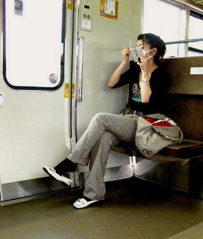 Asian girl on a train